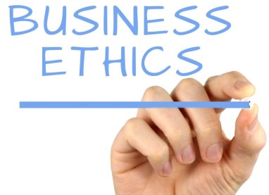 hand with a chalk writing the word business ethics