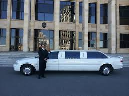 man standing with white limo on the background
